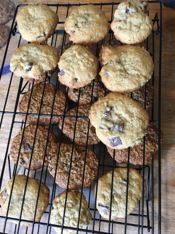 chocolate chip and oatmeal cookies on a cooling on a baking rack