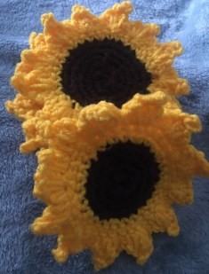 Crocheted coasters of a sunflower theme. These are handcrafted by Second Time Around Homestead.