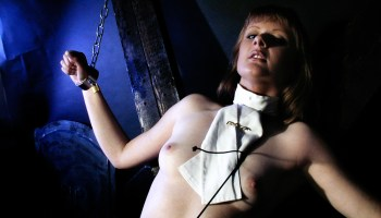 Fetish photo tips nude submissive in dungeon