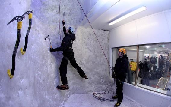 1 man climbing the ice wall at Ellis Brigham