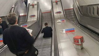 sitting-on-escalator