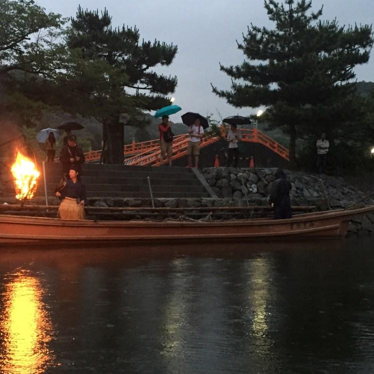 Cormorant fishing boat at night