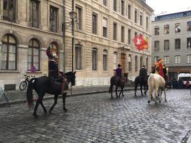 Horsemen in cobbled streets