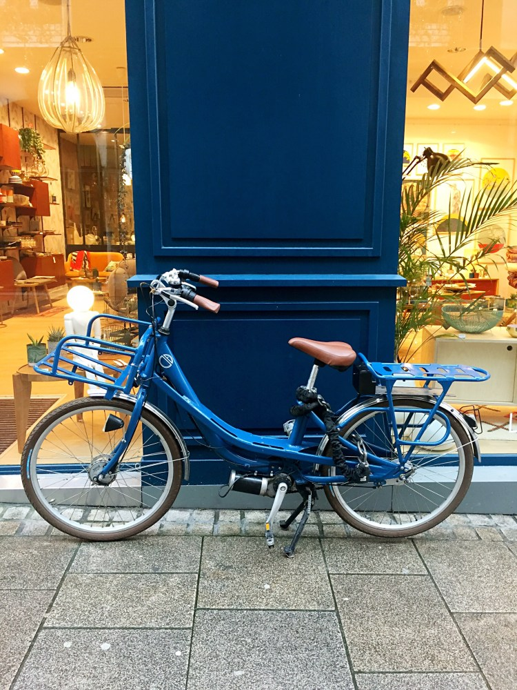 Blue bike outside a blue door, Nantes