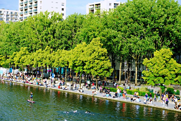 Parisians enjoying Paris Plages - Canal saint martin