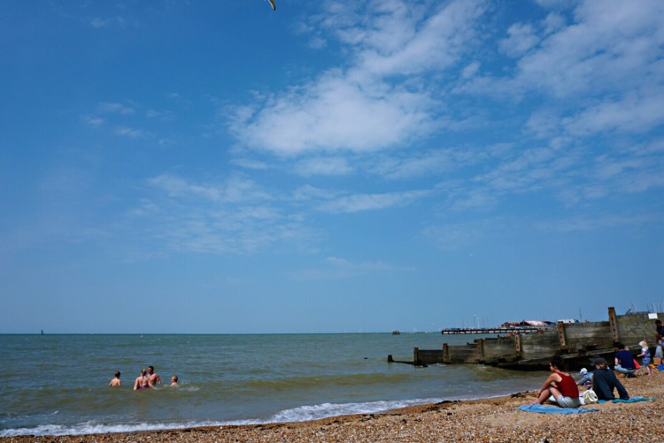 Brave people enjoying the water in Whitstable - Whitstable day trip seaside town things to do