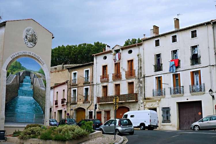Mural on building of the nine locks of Fonserannes - Visit Occitanie