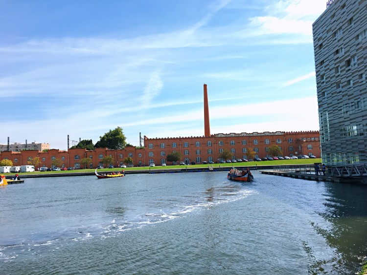 Melia Ria sitting by the canal - Things to do in Aveiro