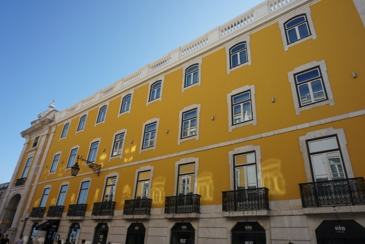 Yellow building in Lisbon - One week in Portugal