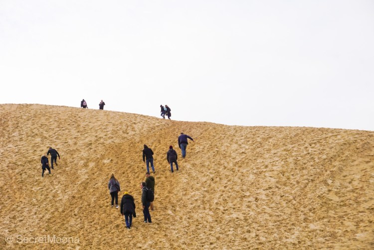 People climbing the steep Dune du Pilat