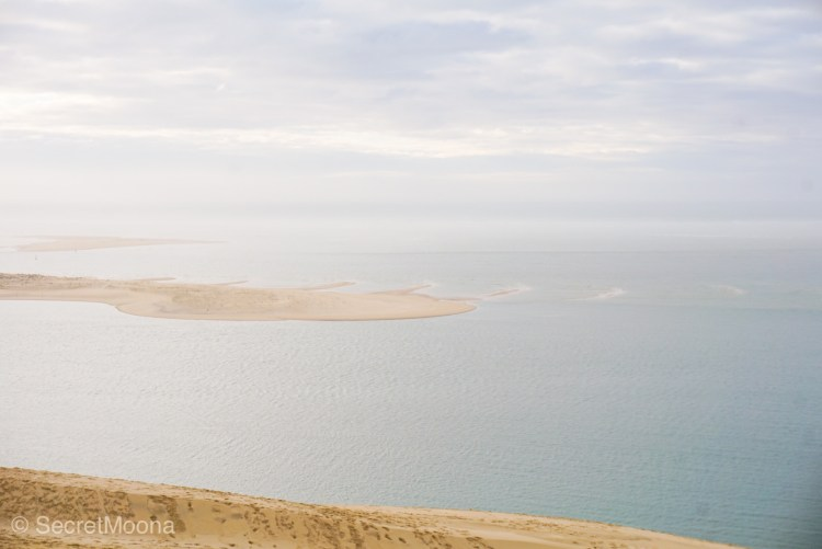 View of sandbank and ocean