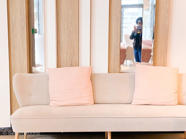 Bright sofa with pink cushions at Hilton Garden Inn Bordeaux Centre