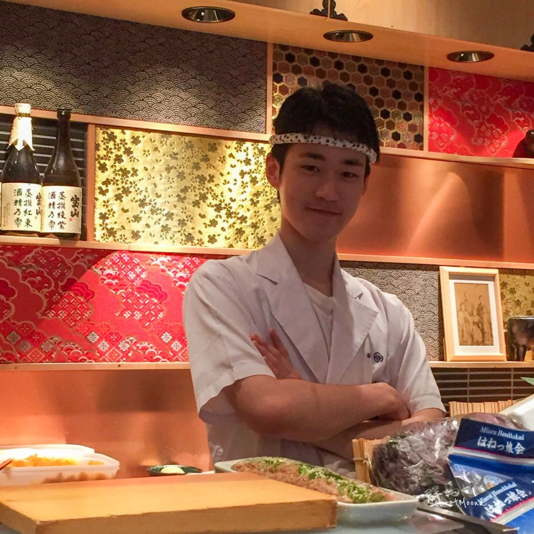 Young sushi chef with folded arms and smile - Tokyo Ginza