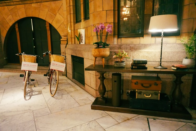 Lobby of the Kimpton Clocktower Hotel with two vintage bikes
