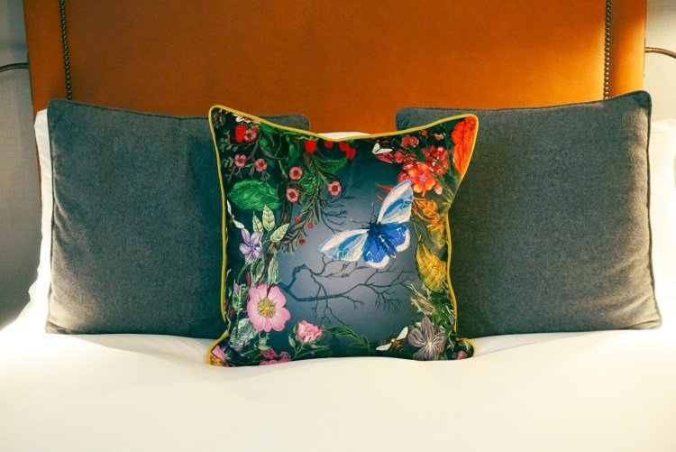 A flower pillow and two plain details