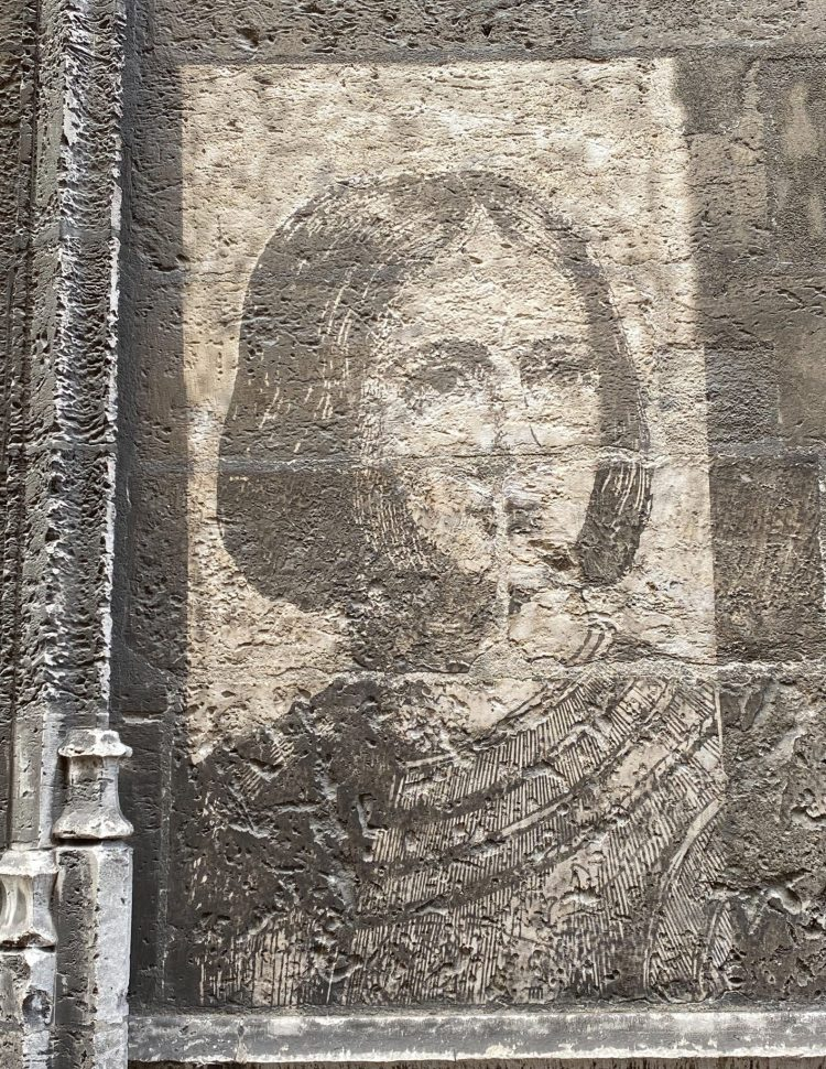 Joan of Arc painted on the wall of a street in Rouen Normandy