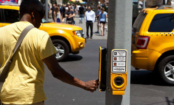 NYC crosswalk idiot buttons