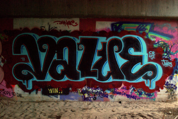 "Graffiti on a wall spelling out the word ""Value"""
