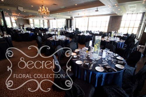 A Navy Blue And Silver Wedding Reception Decoration