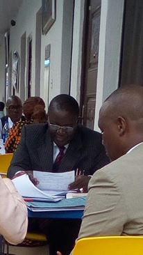 Sir Peter Irabor writing his statement in Force CID Headquarters