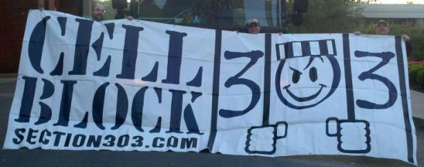 303 Banner in front of Bus