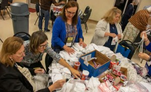 OFS members assemble backpacks for distribution to immigrants in El Paso and other border cities.