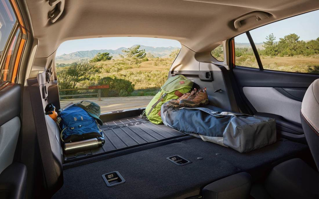 Subaru Image: The view from the spacious rear cargo area of the 2020 Crosstrek, looking out the open rear gate.