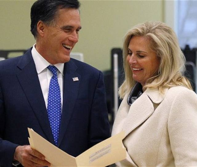 Former Massachusetts Governor Mitt Romney Shows His Ballot To His Wife Ann While Voting In Belmont