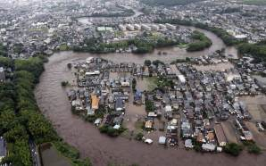 Streets are submerged after a river overflowed its banks in Kumamoto, Kumamoto prefecture on Japan's southern island of Kyushu. Heavy rains hit southern Japan, triggering flashfloods, mudslides and destroying dozens of homes.