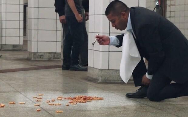 Video Vacuum company brand manager eats off subway floor