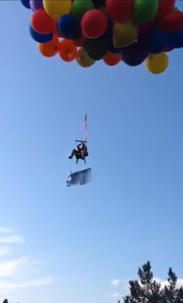 chair with balloons sainsburys garden covers video canadian man arrested after balloon flight telegraph daniel boria who attached giant helium filled to a lawn and soared for miles over calgary canada all clean natural