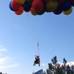 Chair With Balloons Swivel Living Room Video Canadian Man Arrested After Balloon Flight Telegraph Daniel Boria Who Attached Giant Helium Filled To A Lawn And Soared For Miles Over Calgary Canada All Clean Natural