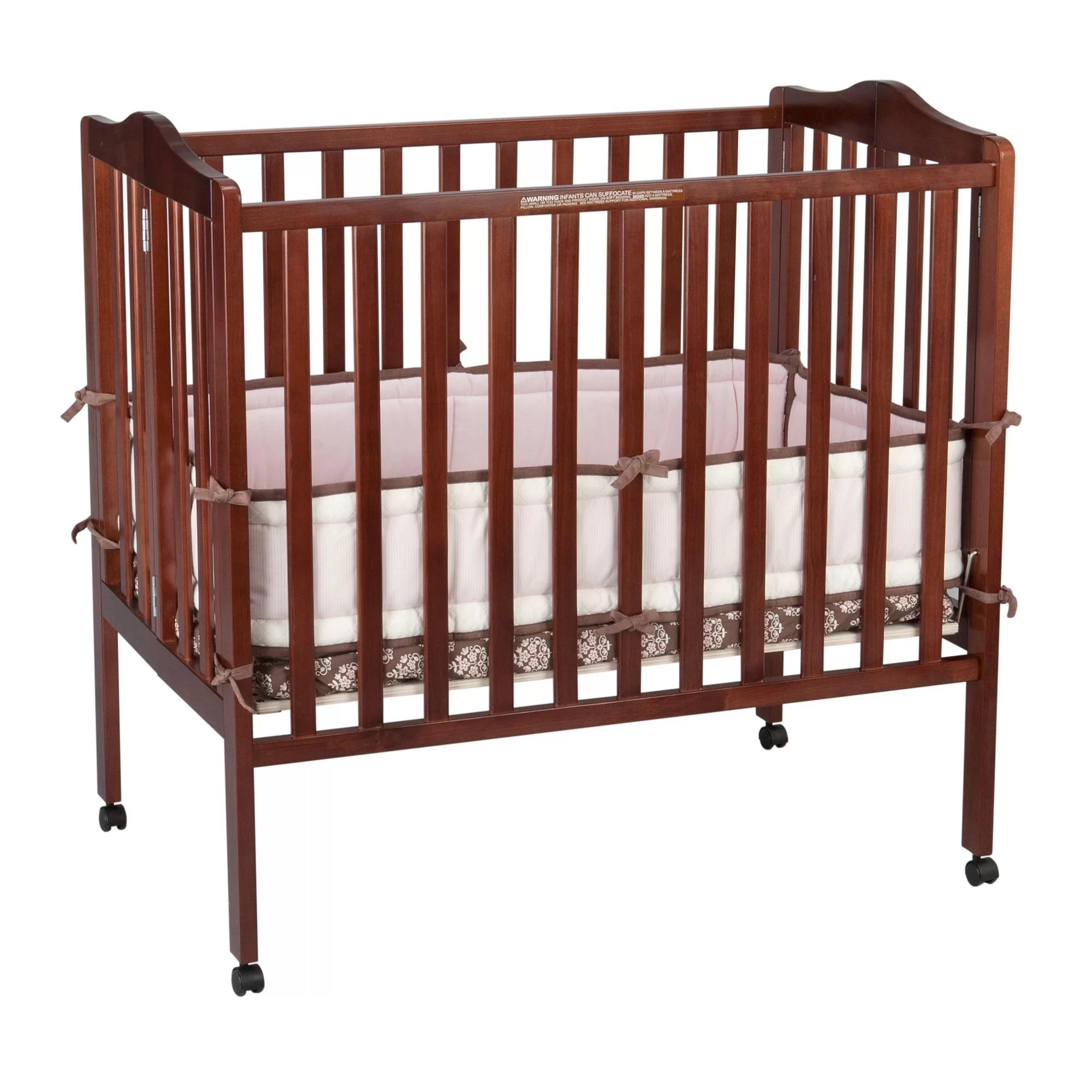 Delta Children Portable Mini Convertible Crib with ...
