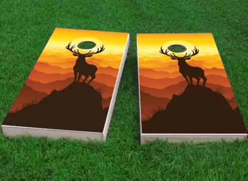 Deer Buck Mountain Sunset Cornhole Game Size: 48 H x 24 W Bag Fill: All Weather Plastic Resin