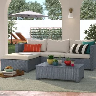 Lachesis 5 Piece Rattan Sectional Seating Group with Cushions