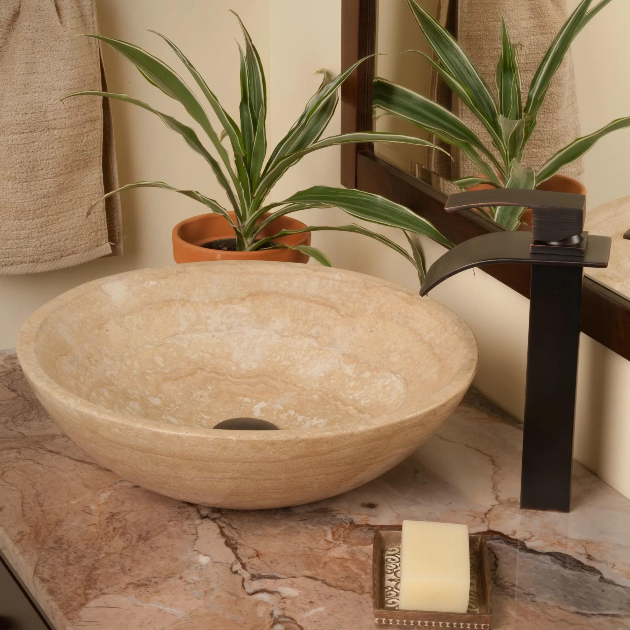 beige travertine stone circular vessel bathroom sink with faucet