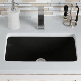 lavabo rectangulaire en porcelaine vitrifiee sous le comptoir avec trop plein