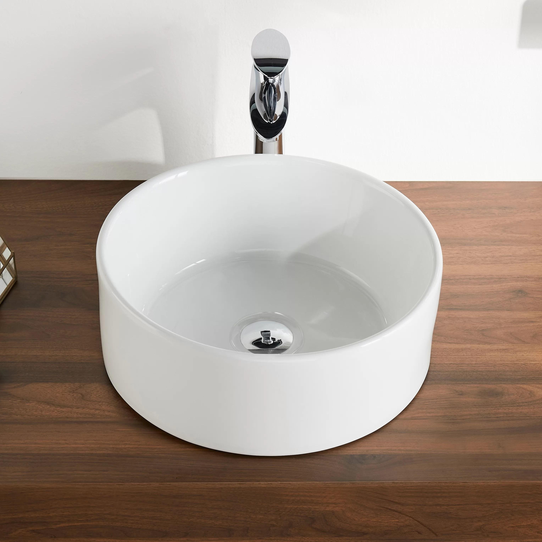 white ceramic circular vessel bathroom sink