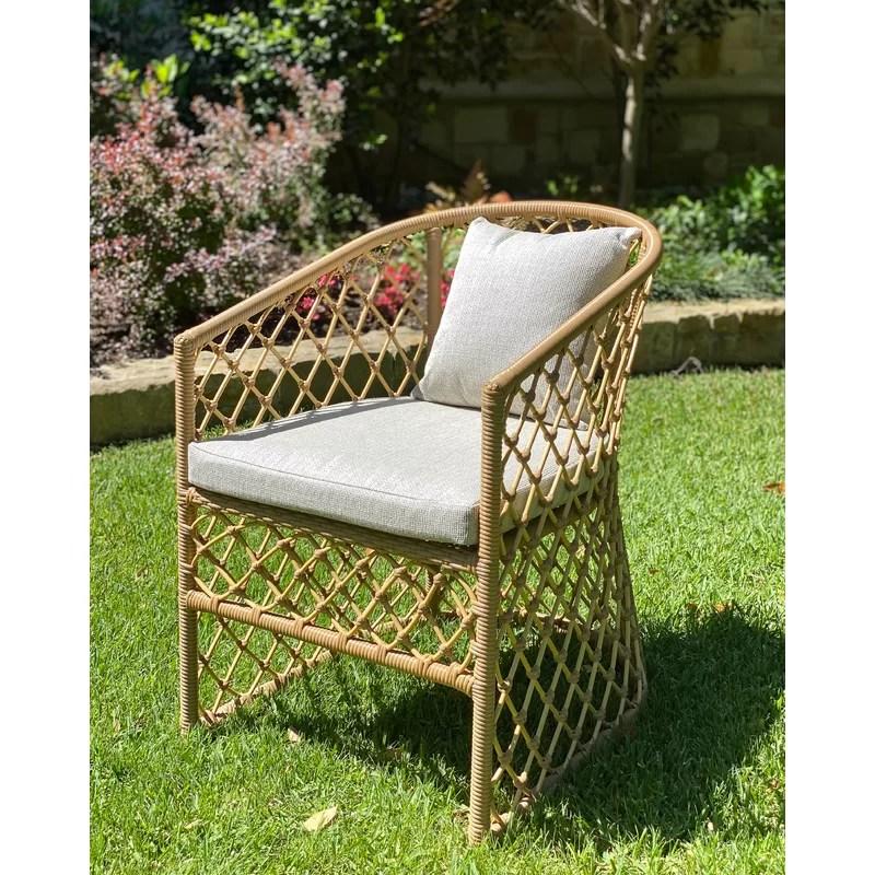 mckinzie rattan patio dining armchair with cushions