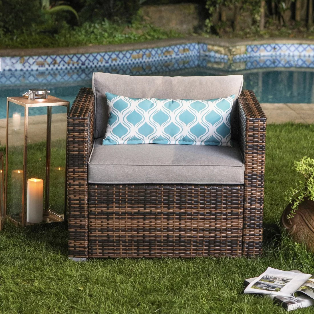 eitzen outdoor furniture all weather mottlewood brown wicker single chair w warm gray thick cushions teal pattern pillow