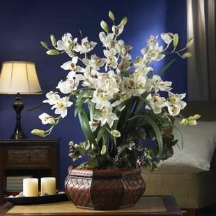 large cymbidium orchid centerpiece in planter