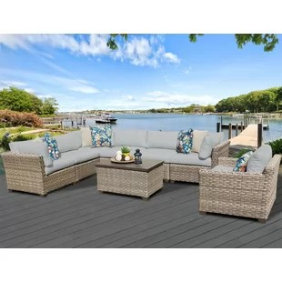 rochford 8 piece rattan sectional seating group with cushions