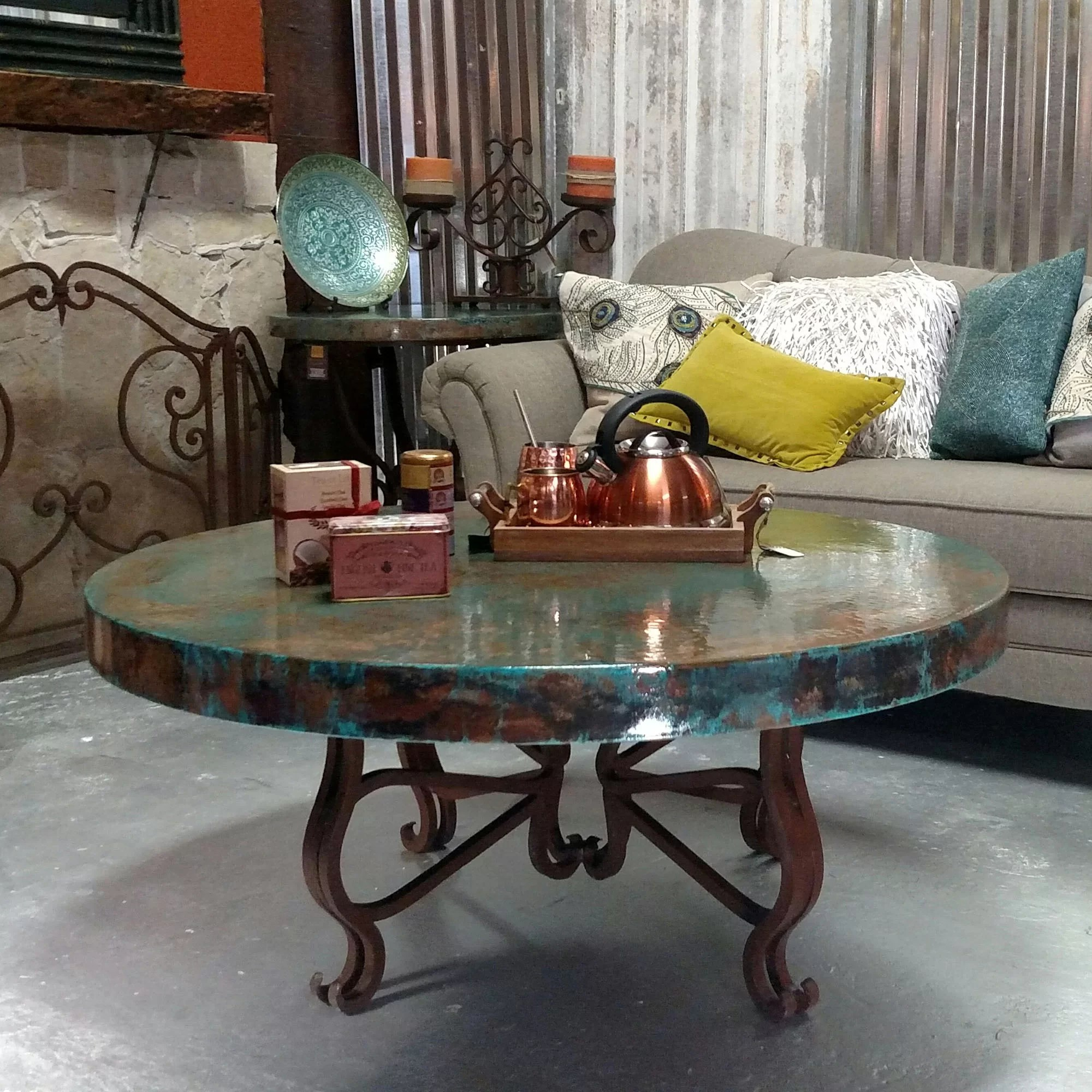 luxurious wrought iron coffee table embellished with a 48 round oxidized copper top