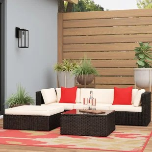 huang 5 piece rattan sectional seating group with cushions