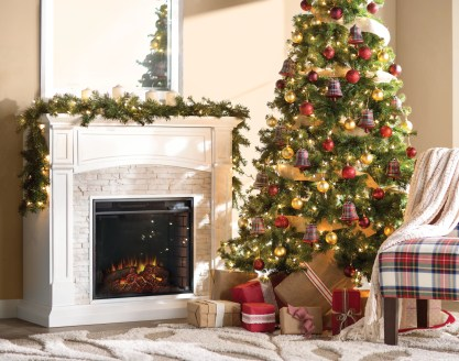 Red and gold christmas tree facing lit hearth