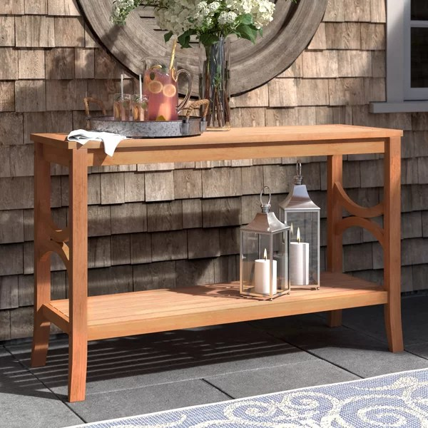 A teak dining table of old teak wood is warm and atmospheric and fits in really any interior. Brunswick Teak Buffet & Console Table & Reviews   Birch Lane