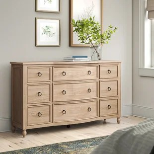 If you love rustic bedroom design but want to update it with a contemporary touch, you might love the striking bed frame sets the stage for a luxurious look and the refined wood tones of the dresser. farmhouse rustic dressers birch lane