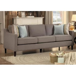 wood frame living room furniture apartment sets exposed sofa wayfair ca wooden upholstered with contoured track arms and 4 contrast pillows grey