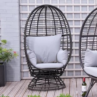 outdoor rattan armchair uk dining room chair covers with buttons egg chairs wayfair co sharee garden cushions