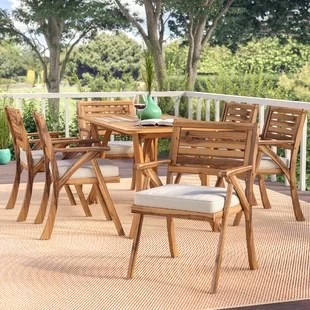 outdoor table and chairs wood hammock sling with chair pad furniture birch lane coyne 7 piece dining set cushions